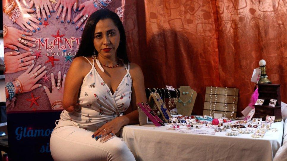 Venezuelan jeweller defies disability to start over in exile