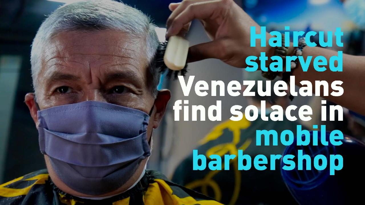 Haircut-starved Venezuelans find solace in mobile barbershop