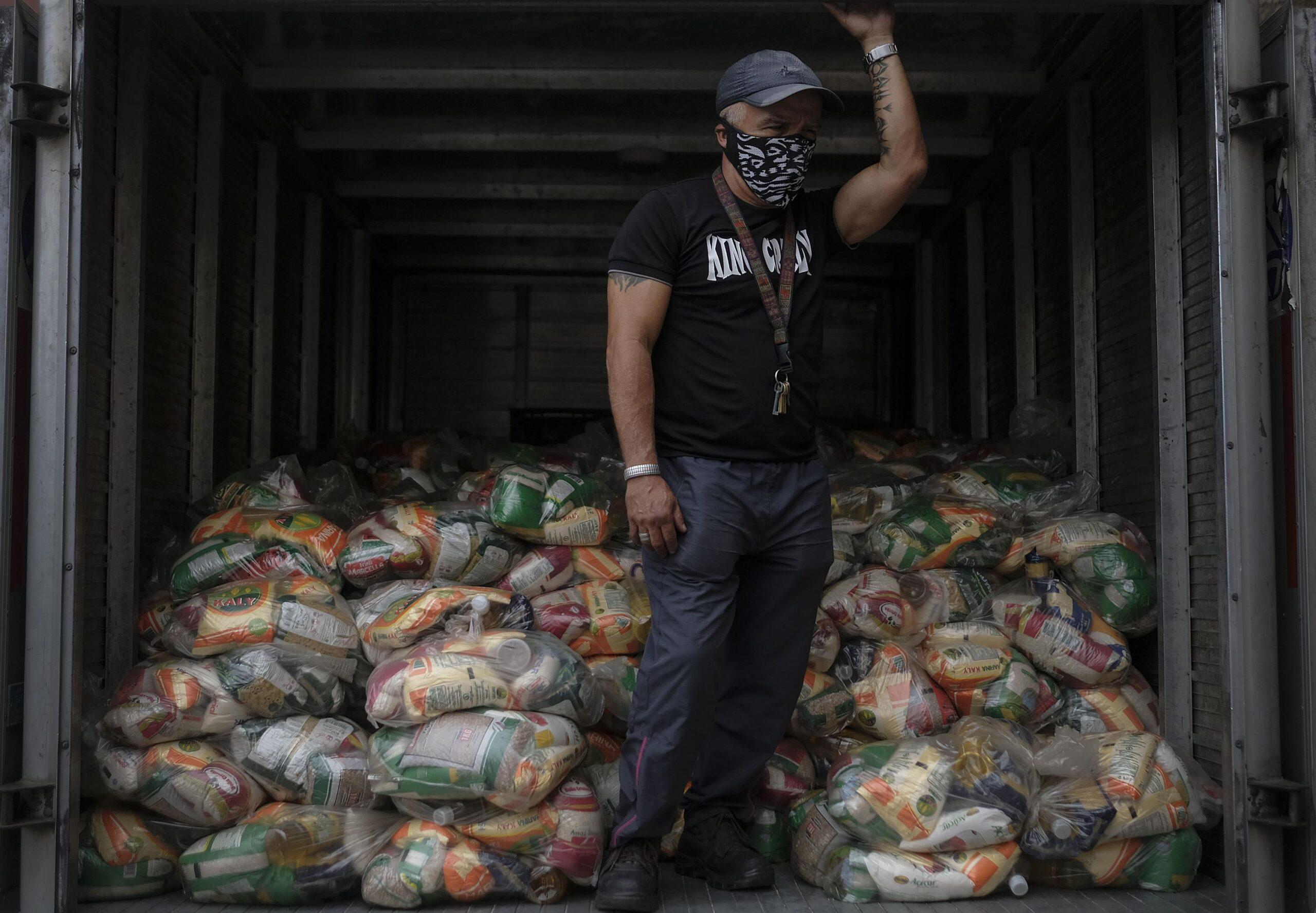 Venezuela's Maduro begins allowing aid against hunger, virus